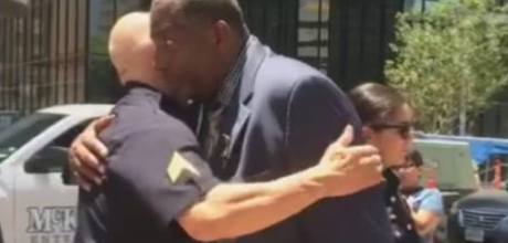 Dallas residents show up at Dallas Police Department headquarters as a spontaneous line of hugs develops. A wonderful healing scene of hope.